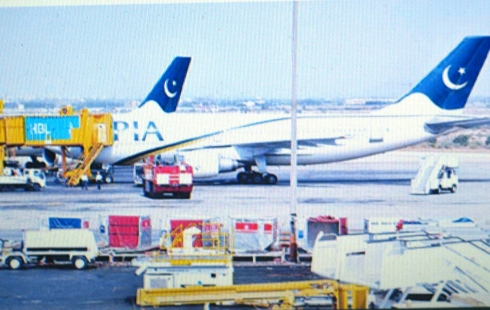 Airbus A310-308 registration AP-BEB after landing at Jinnah International Air Port (JIAP) Karachi on November 18, 2013. Note a Pakistan Civil Aviation Authority (CAA) fire tender positioned near engine number o